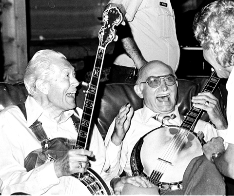 Brother Oz and Grandpa Jones enjoy a joke backstage
